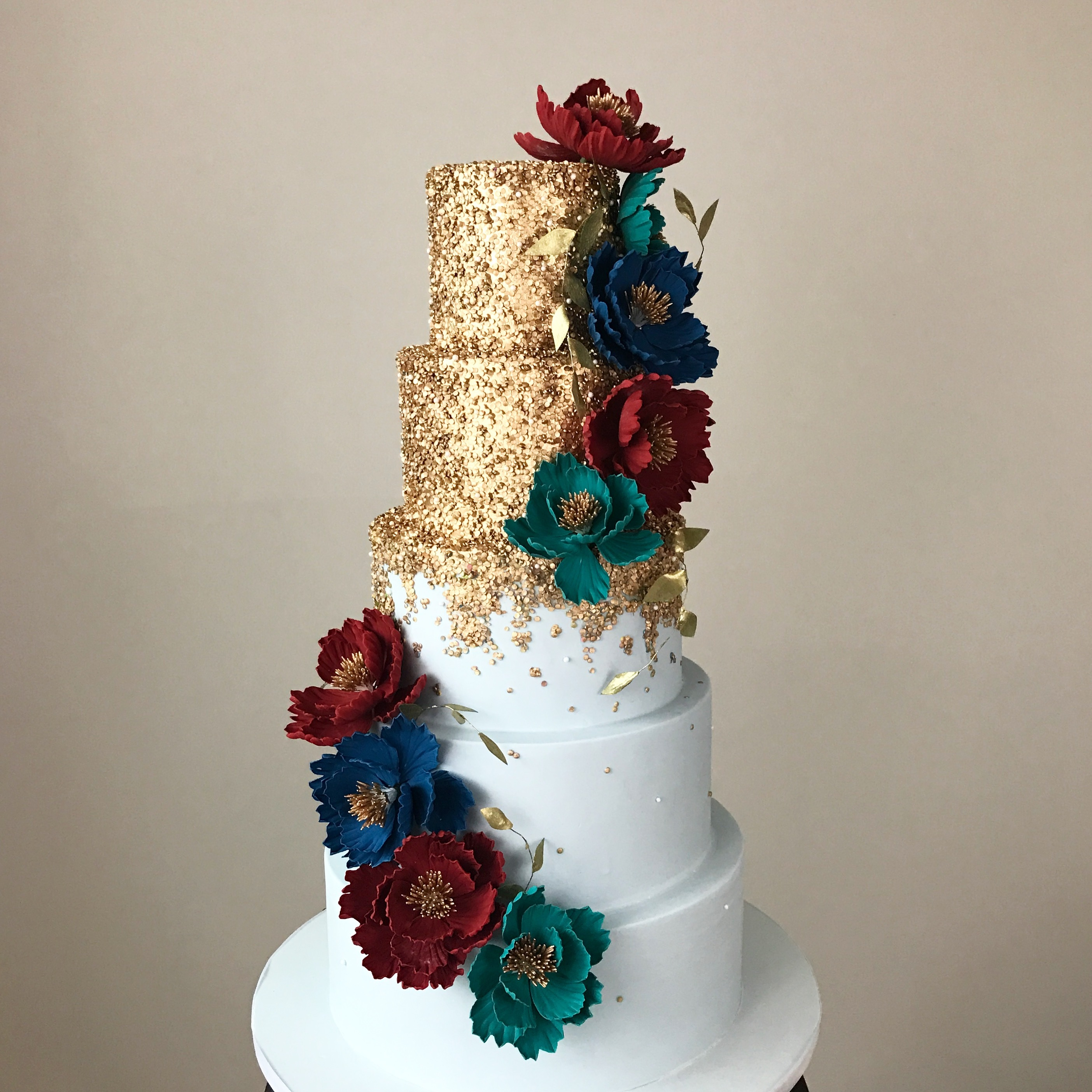 White fondant wedding cake with  gold sparkle