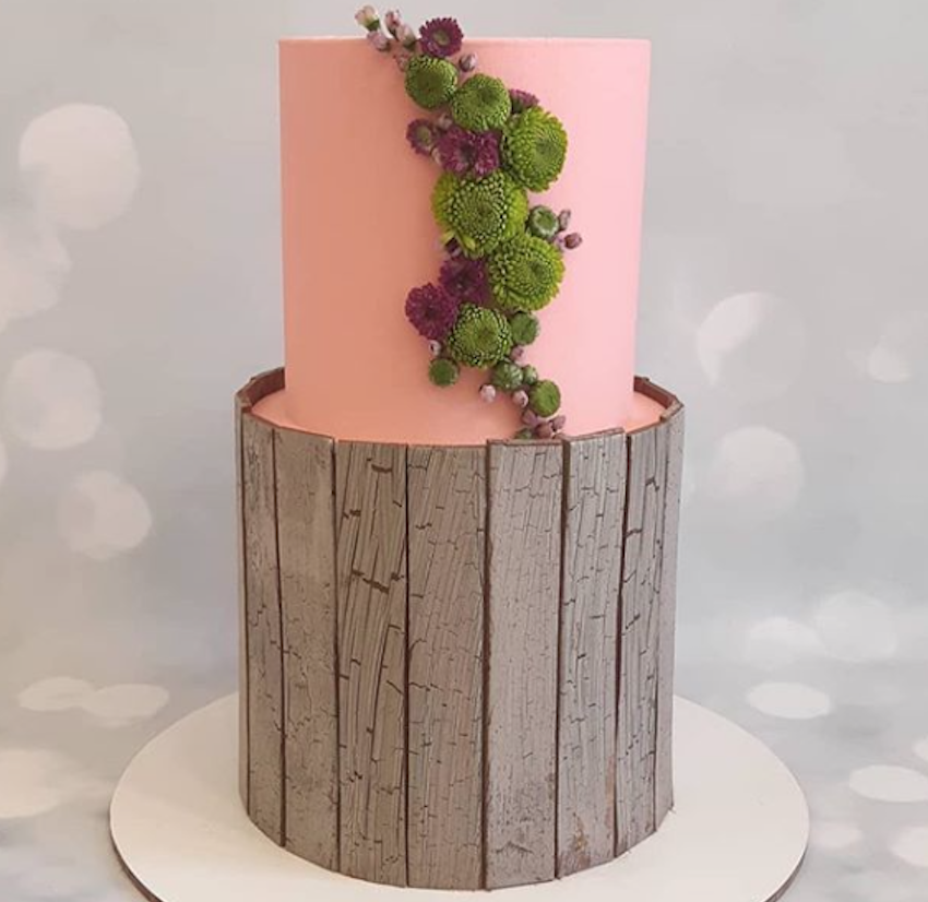 Pink and wood panel effect woodland wedding cake