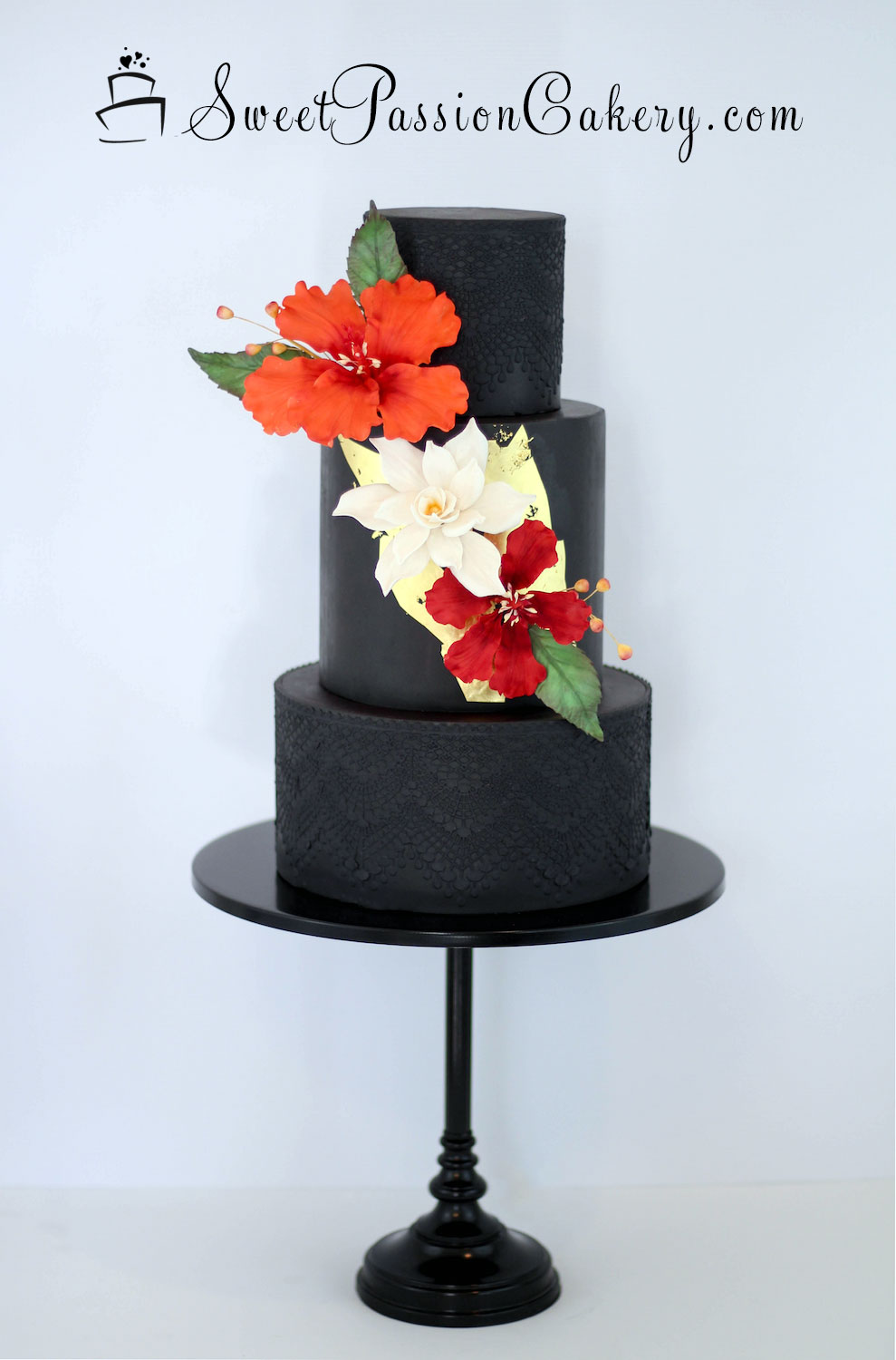 All black wedding cake with bold colored sugar flowers