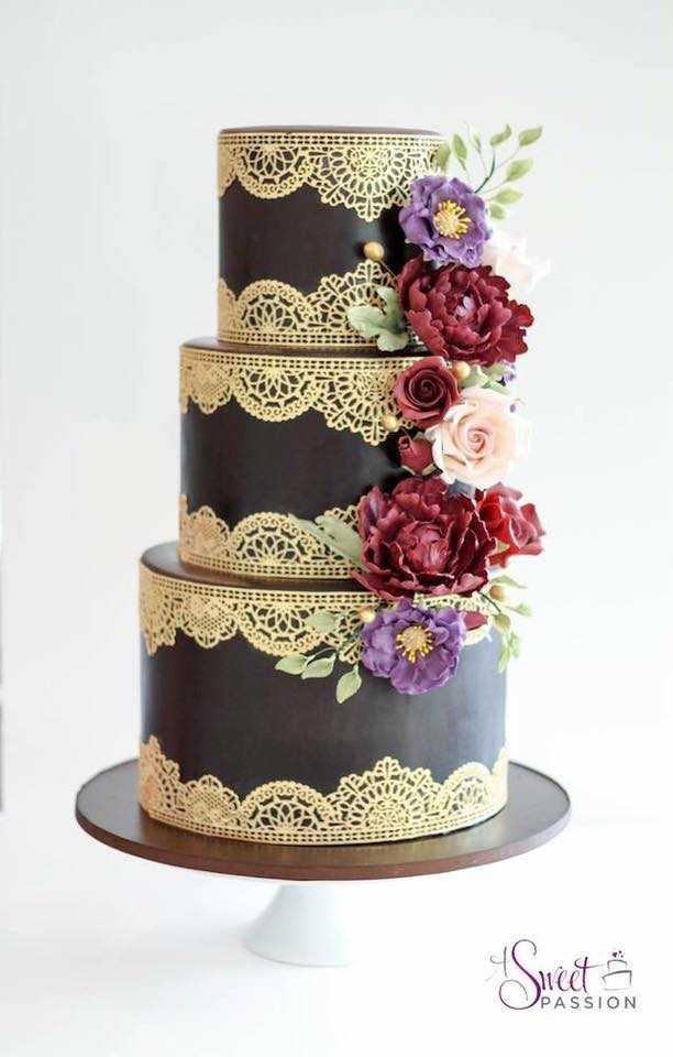 Elegant brown fondant wedding cake with gold detailing