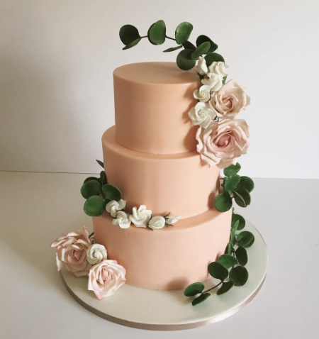 Peach fondant wedding cake with sugar flowers