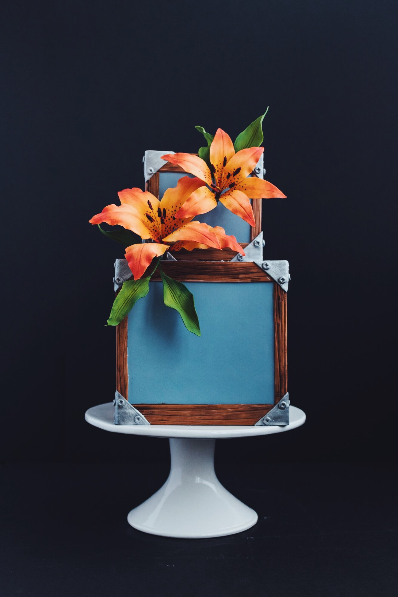 Blue wedding cake with tropical flowers