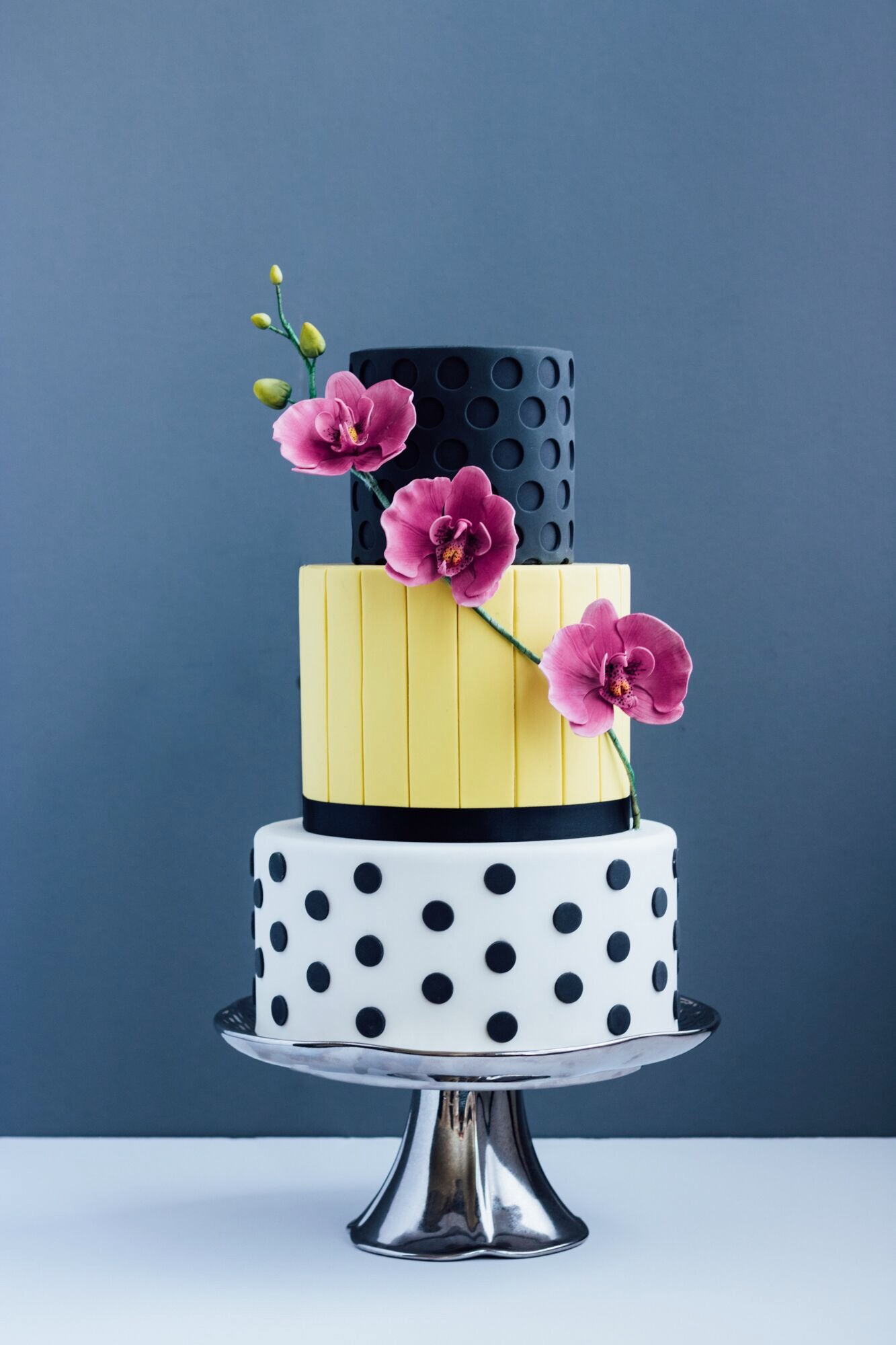 Black and white polka dot fondant wedding cake with yellow