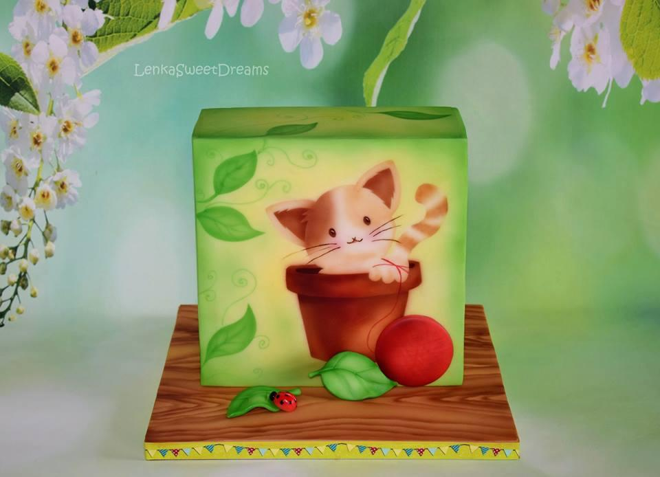 Bright green handprinted kitten themed cake