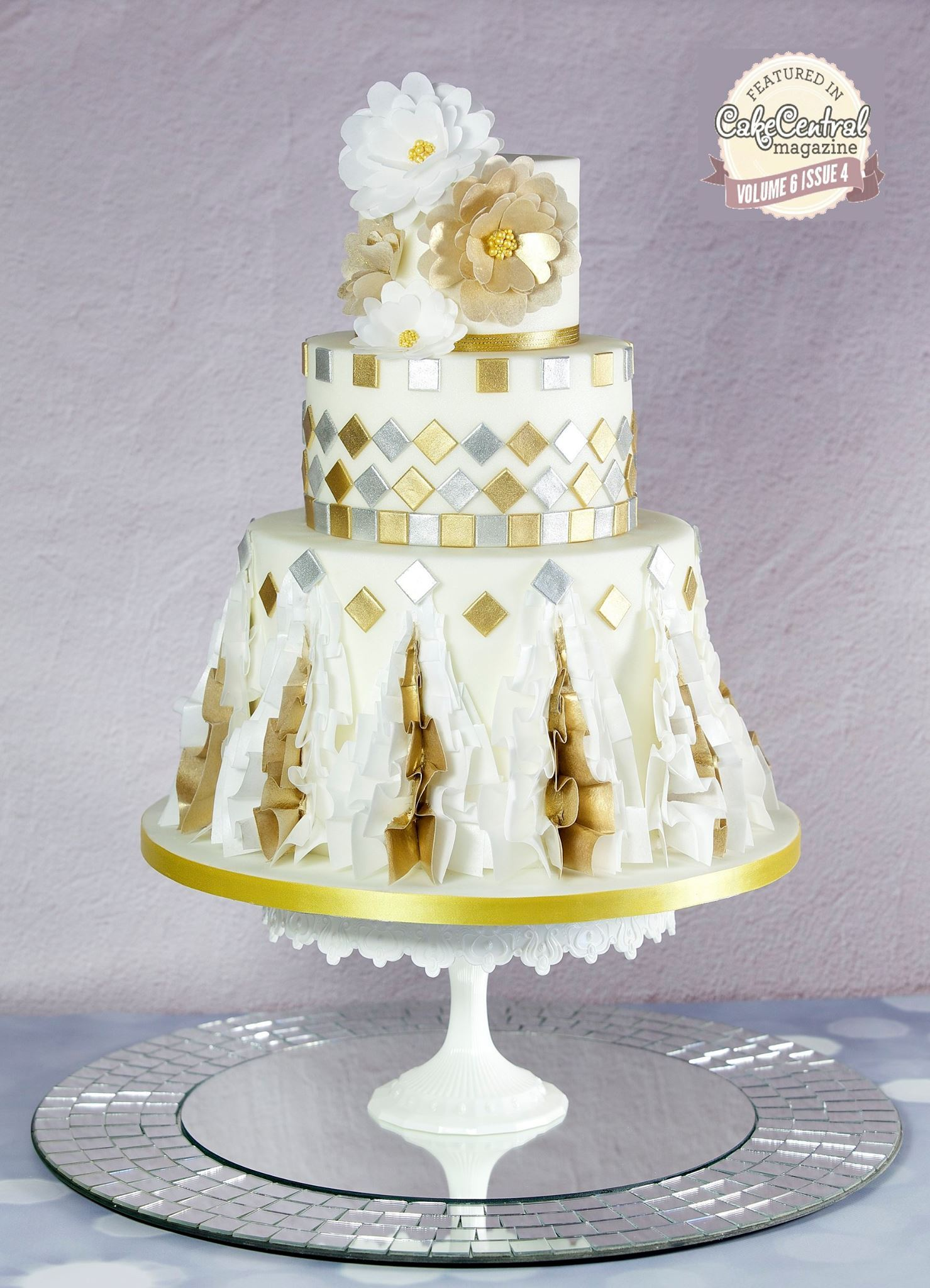 White ruffled fondant wedding cake with gold