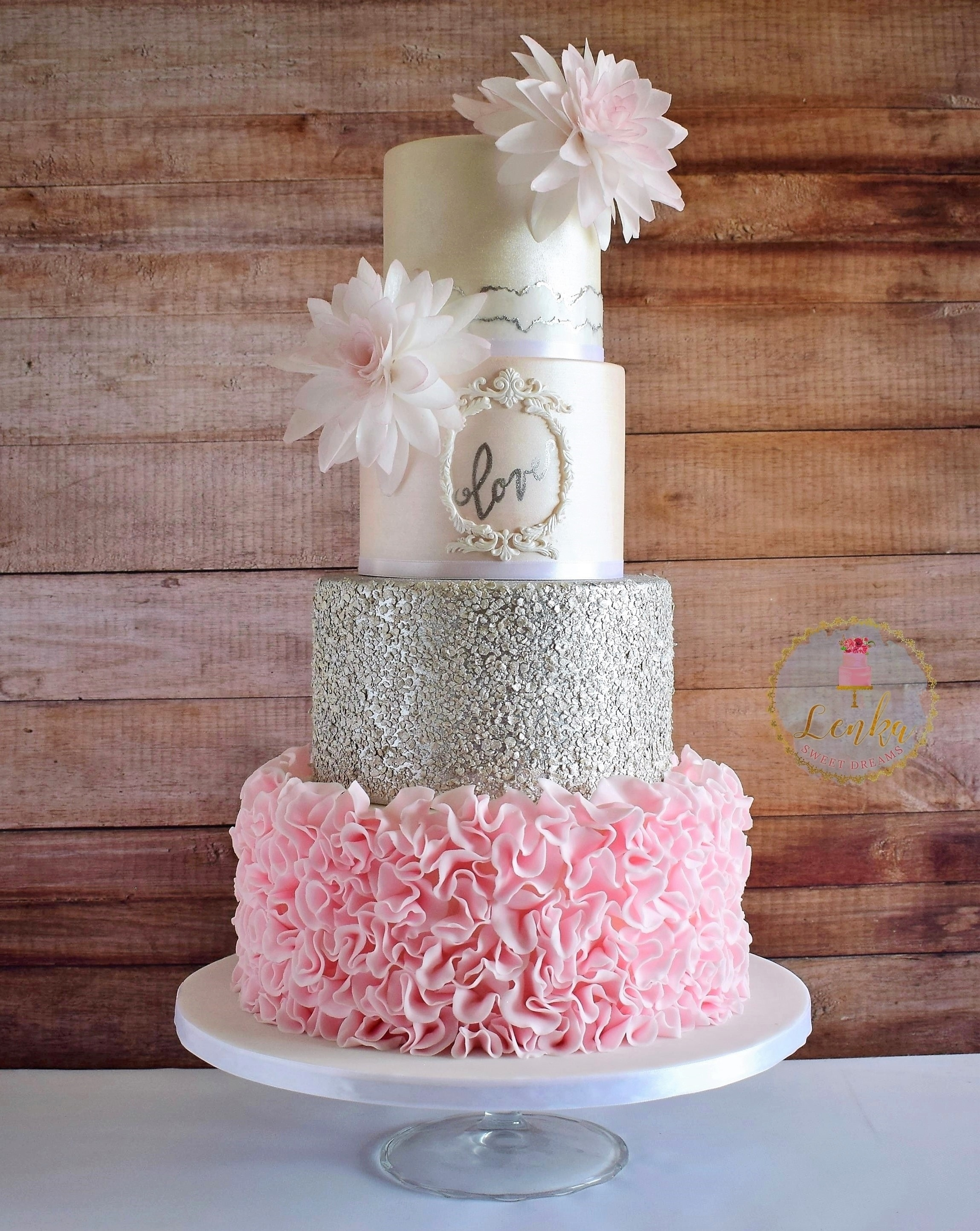 Light pink and gray fondant ruffle wedding cake