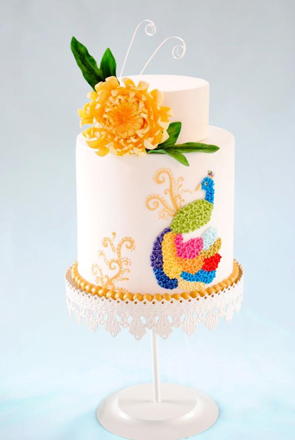 White fondant cake with orange sugar flowers