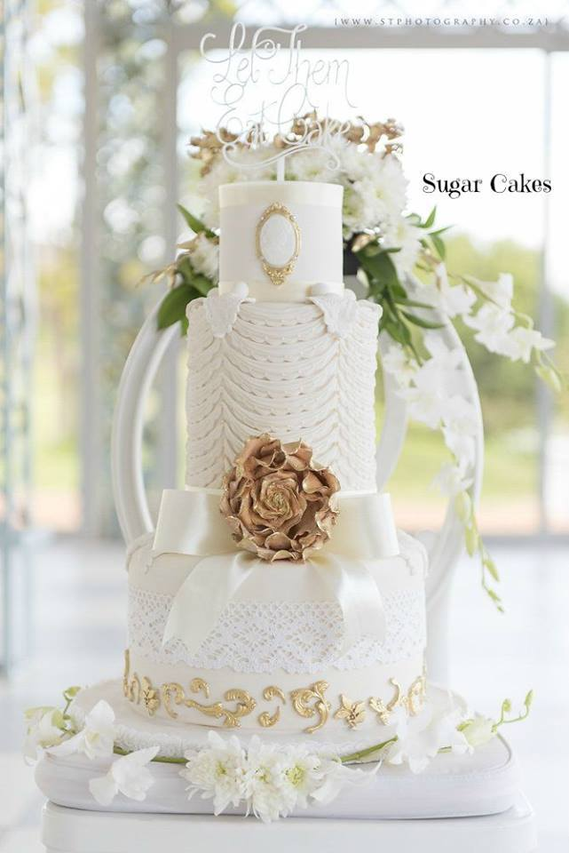 White and gold embossed wedding cake