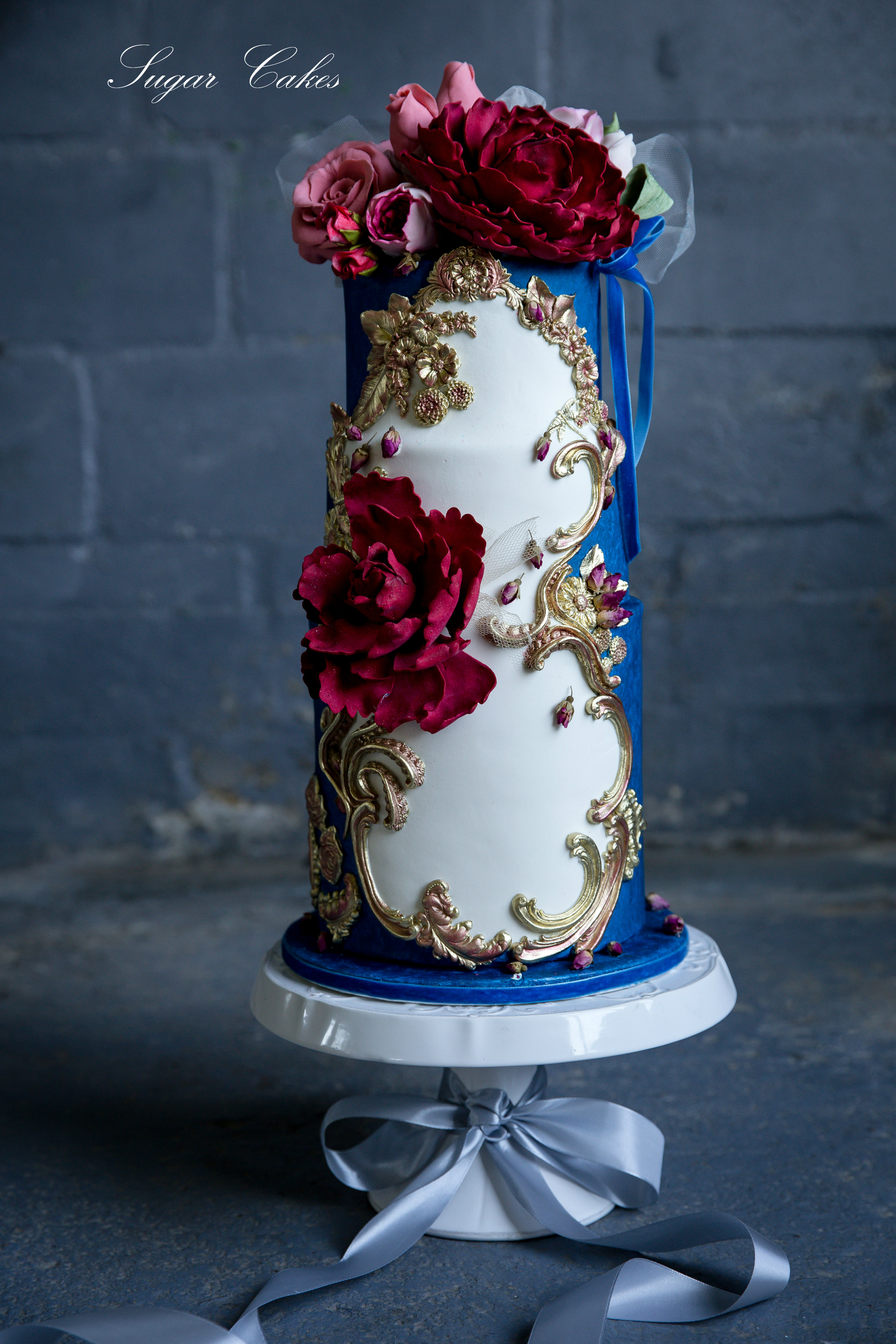 Blue and white baroque styled fondant wedding cake