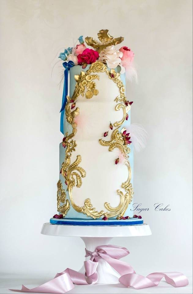 Vintage bohemian styled fondant wedding cake with gold trim