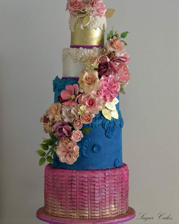 Blue and burgundy fondant wedding cake with flowers