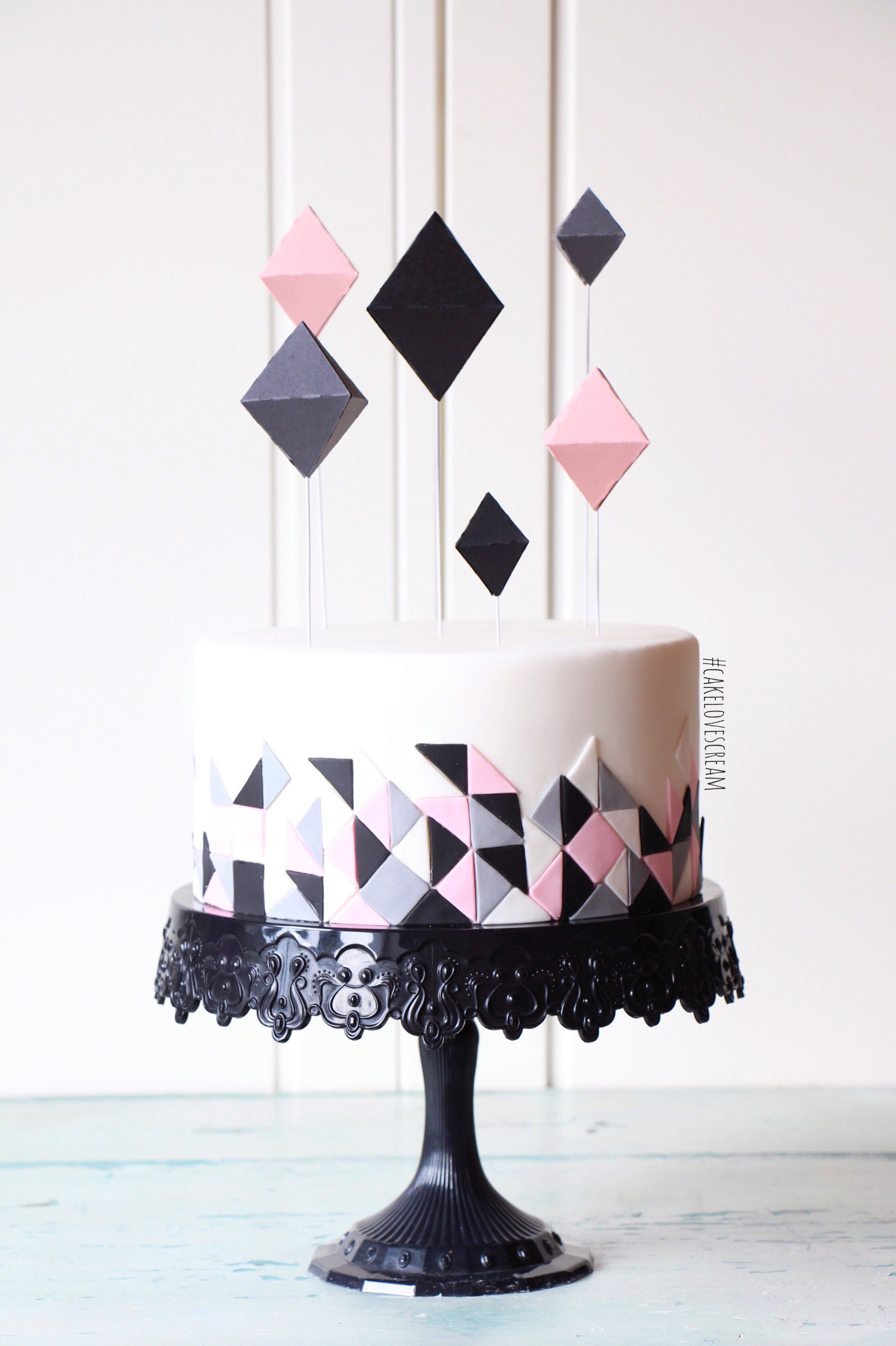 Black pink and geometric fondant cake