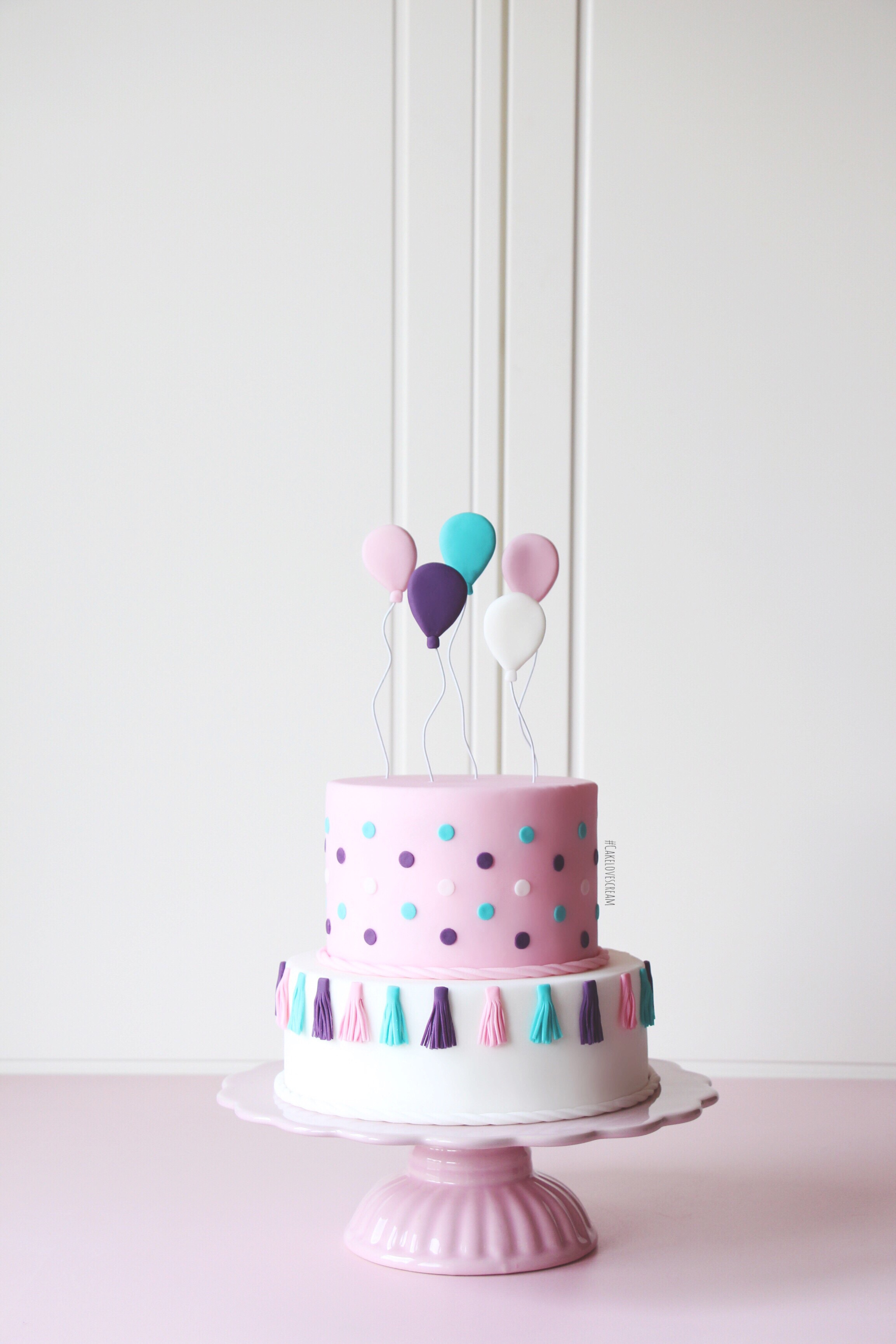 Pink and white balloon birthday cake