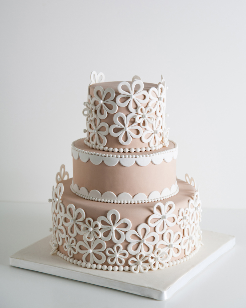 Taupe fondant wedding cake with white floral applique