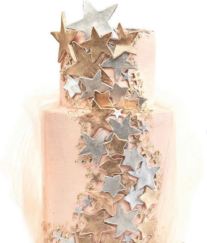 Rose gold fondant wedding cake with stars