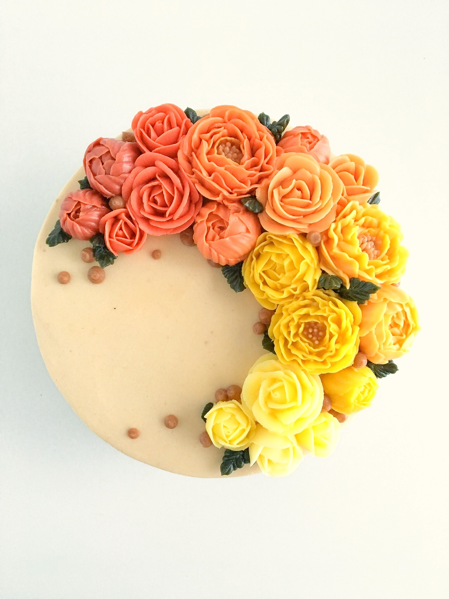 Orange and yellow buttercream floral cake