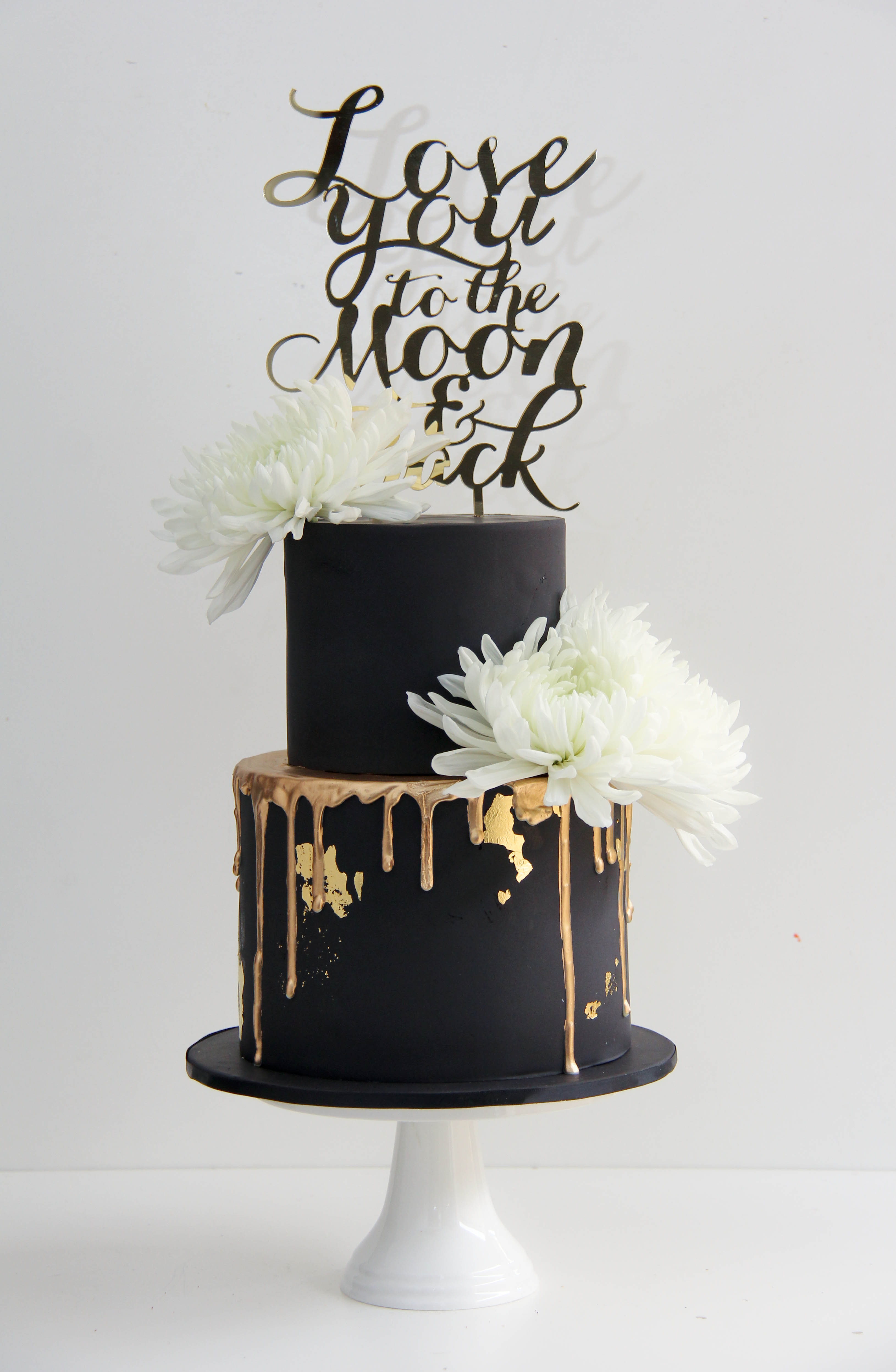 Black drip wedding cake