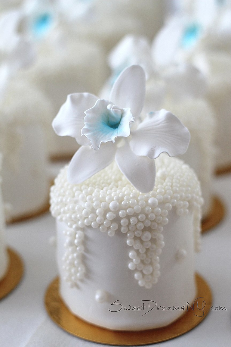 All white with sugar pearls petite fours