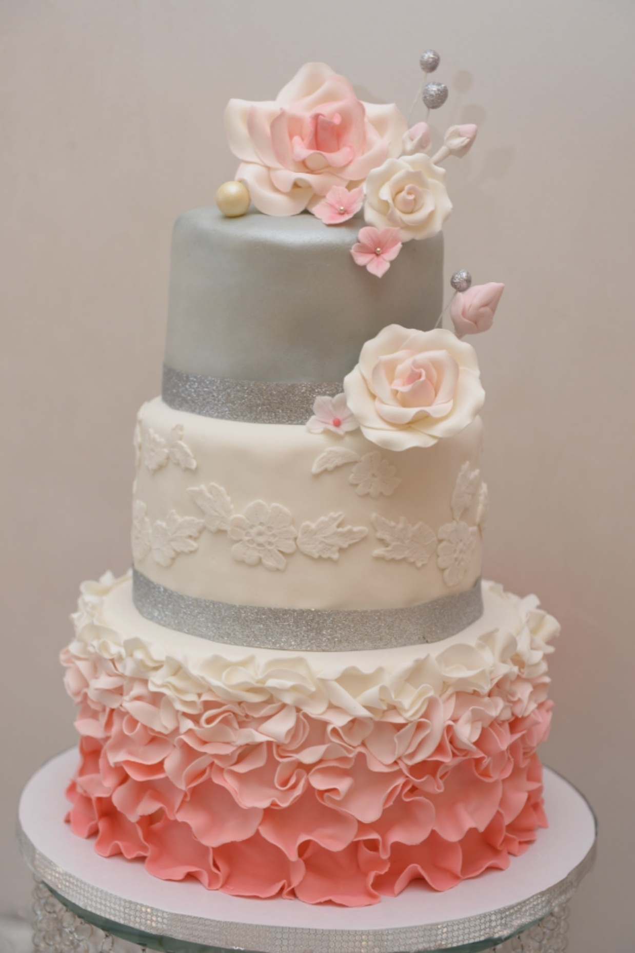 Gray wedding cake with pink ombre ruffles