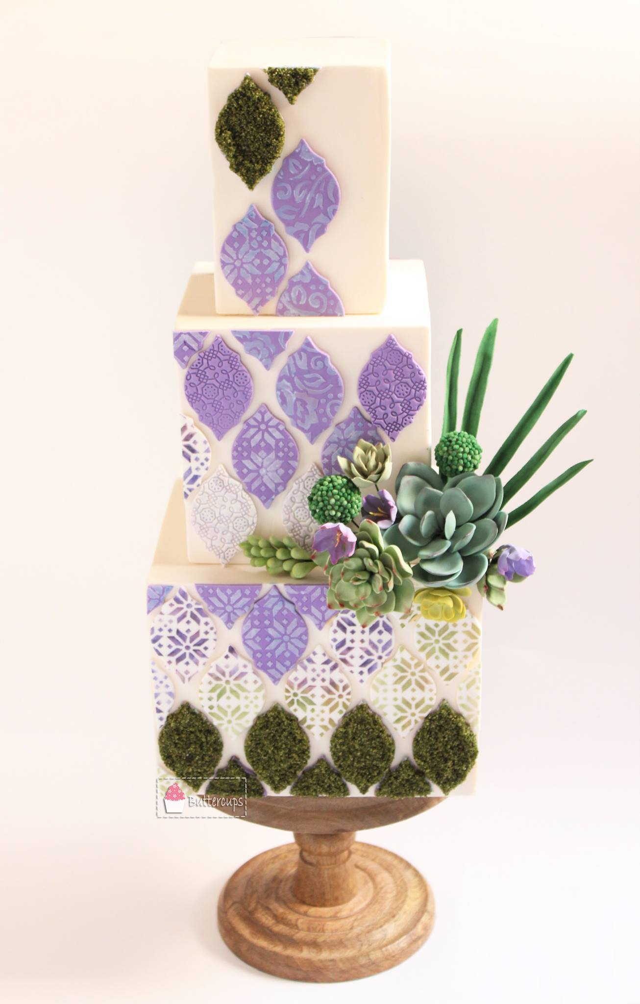 White fondant cake with moss effect and succulents