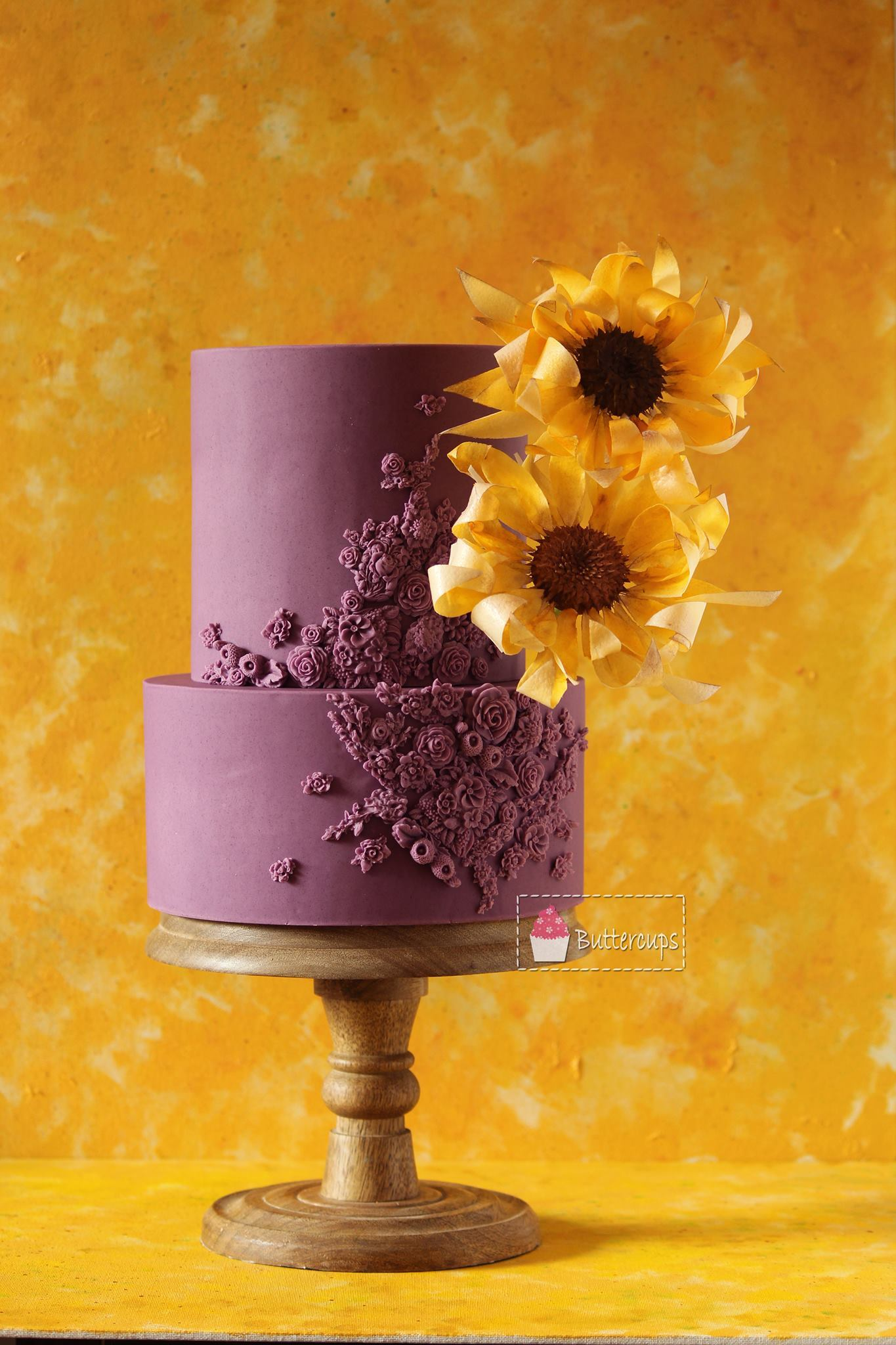 Burgundy fondant wedding cake with sunflower
