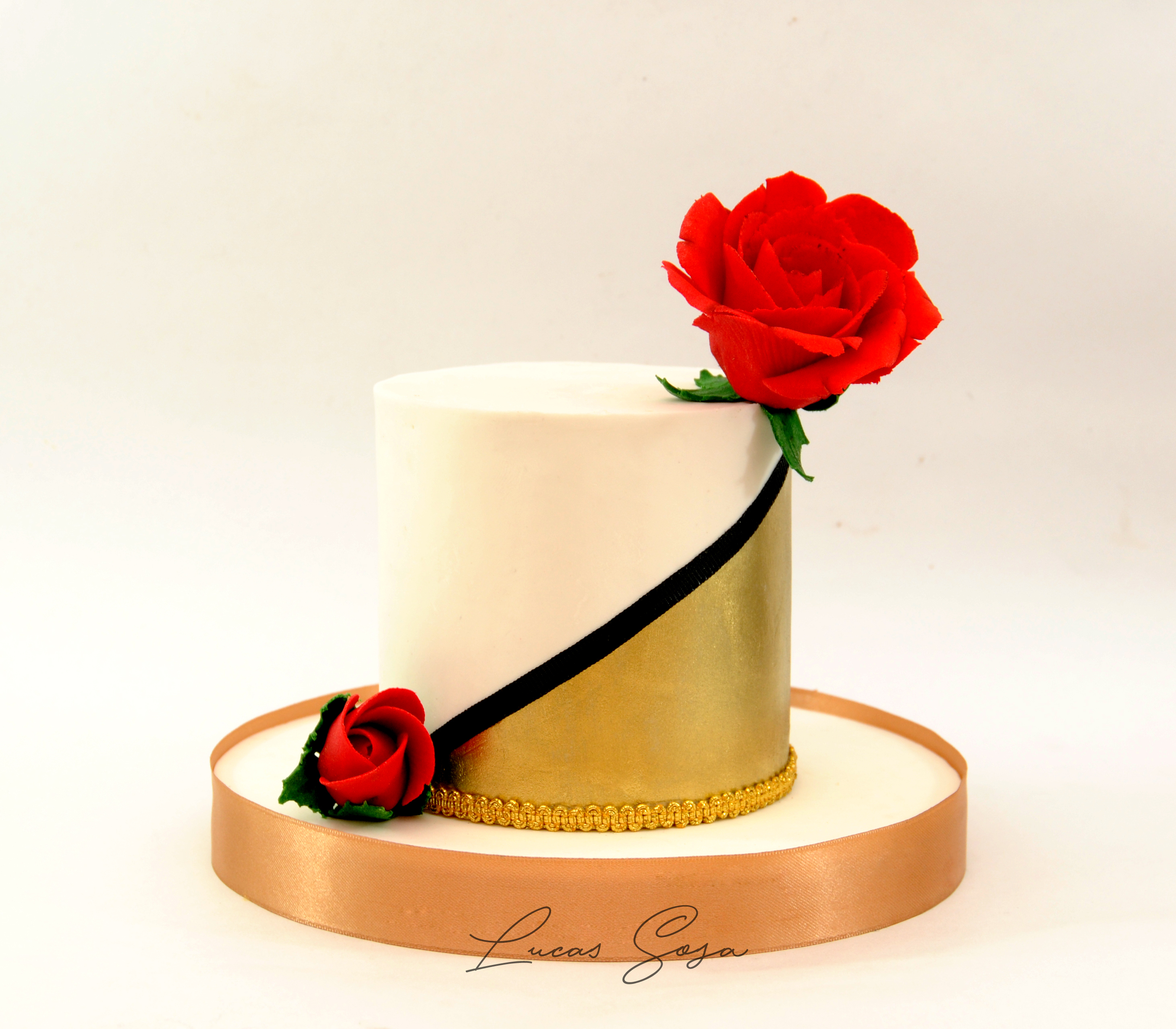 White fondant cake with red sugar flowers