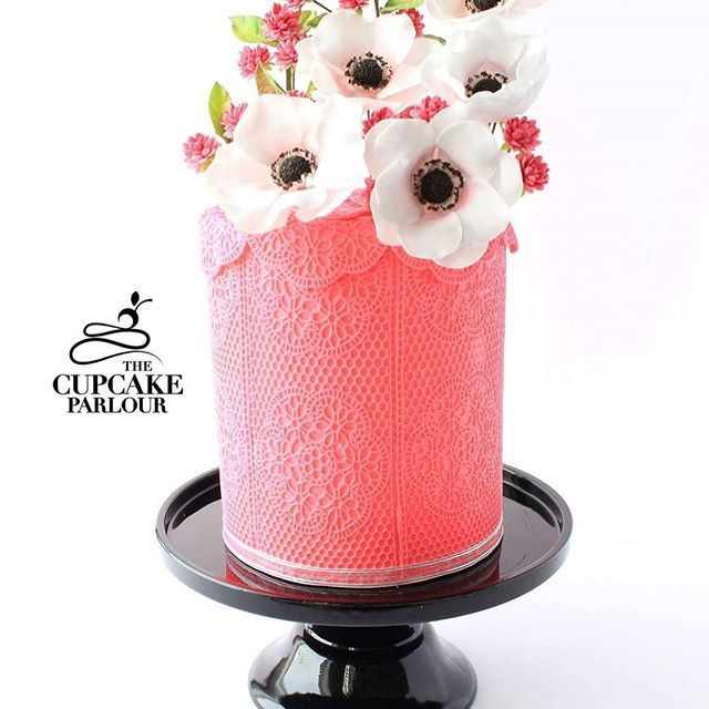 Bright pink fondant wedding cake with gum paste anemones