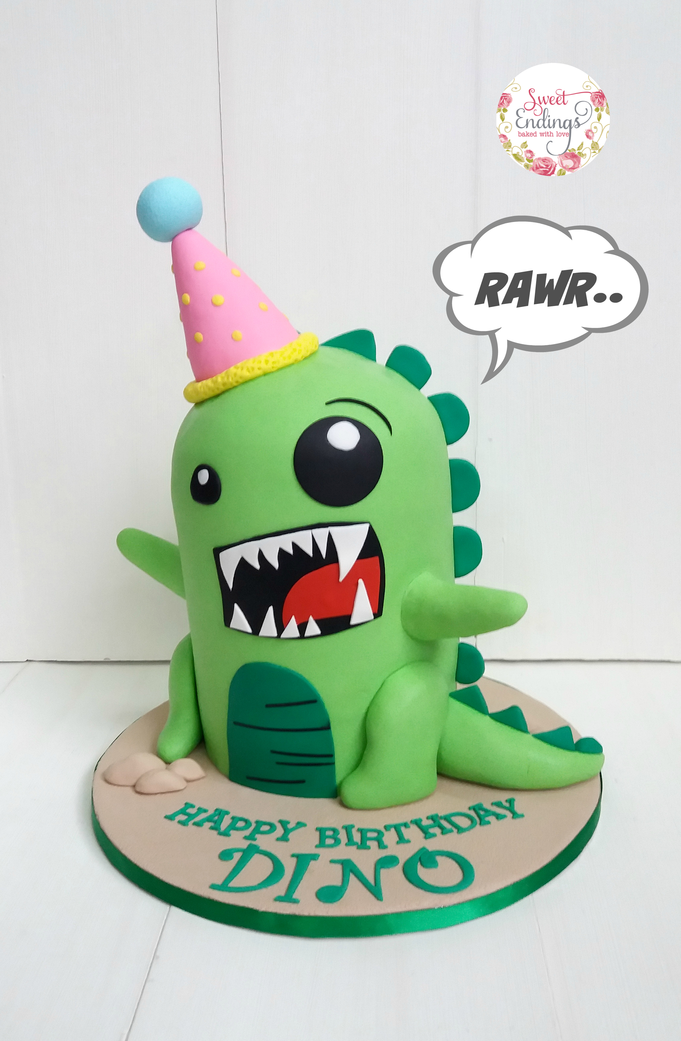 Green birthday dinosaur cake
