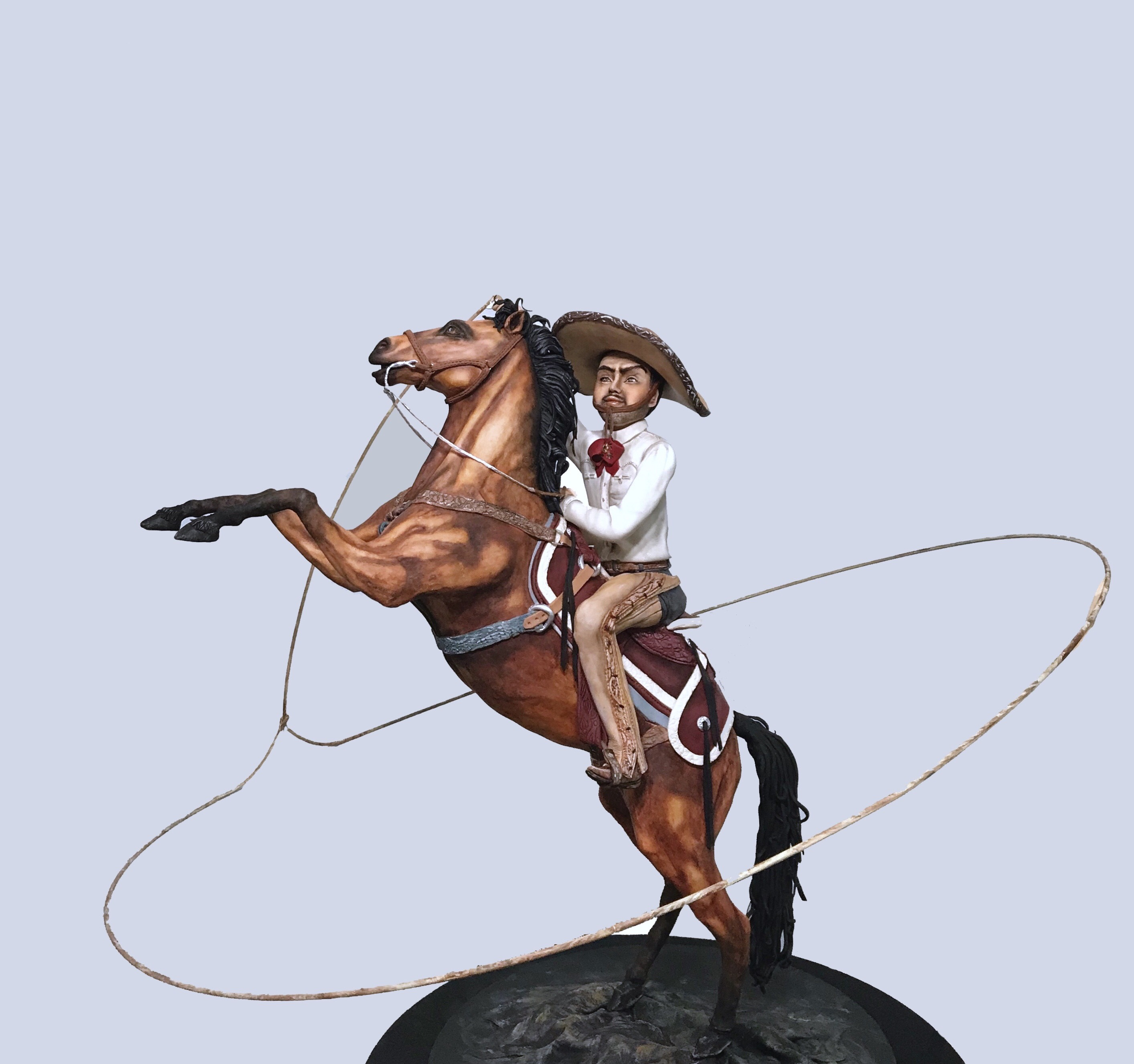 Mexican cowboy on horse figurine