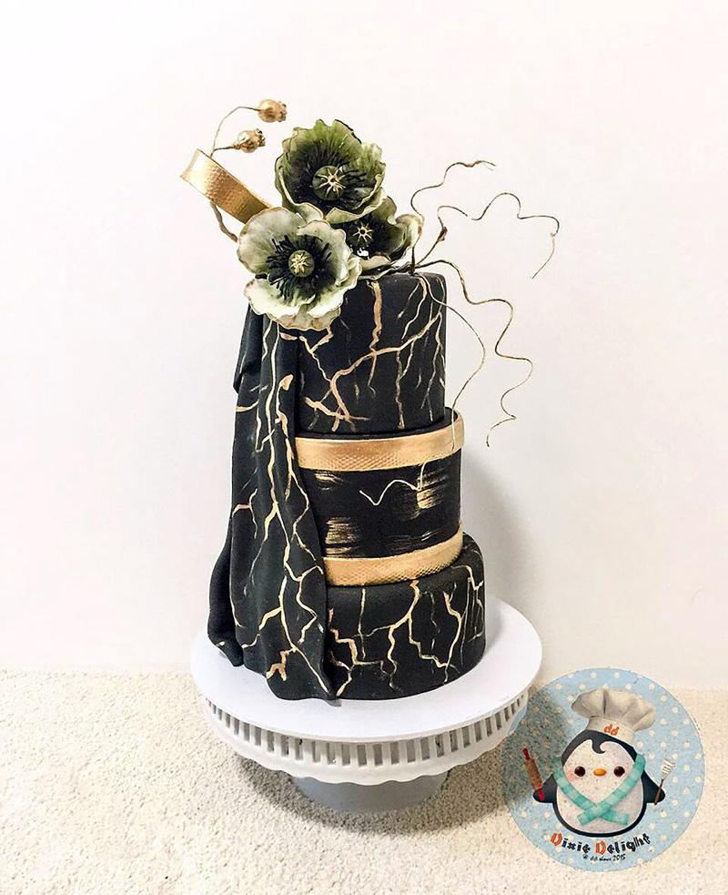 Black fondant wedding cake with black sugar flowers