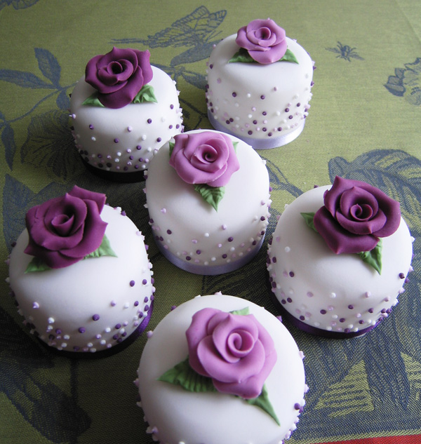 White and purple tiny fondant cakes