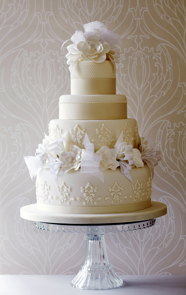 Elegant ivory fondant wedding cake with sugar flowers