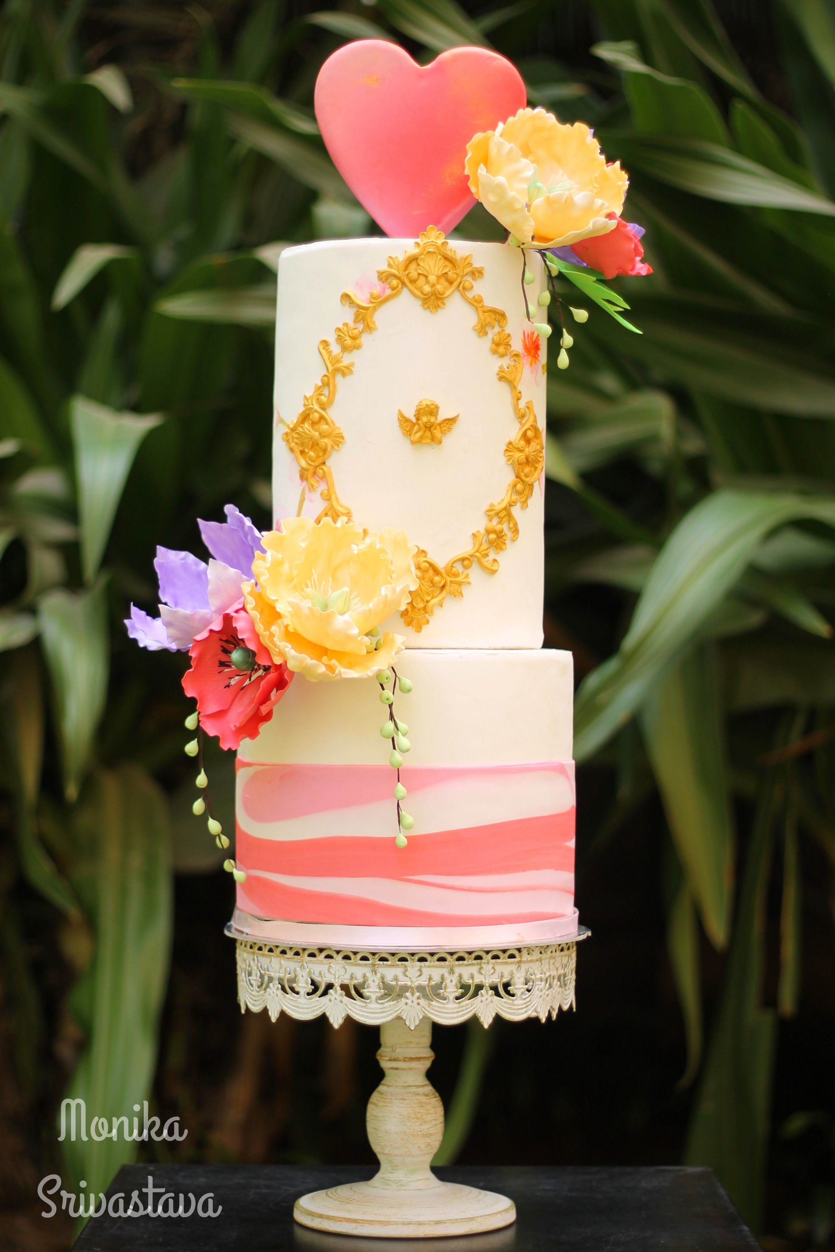Ivory fondant wedding cake with heart details