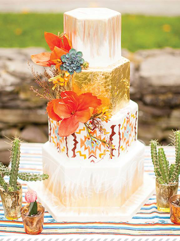 South Western styled fondant wedding cake with orange sugar flowers