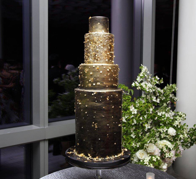 Black fondant wedding cake with gold sparkle