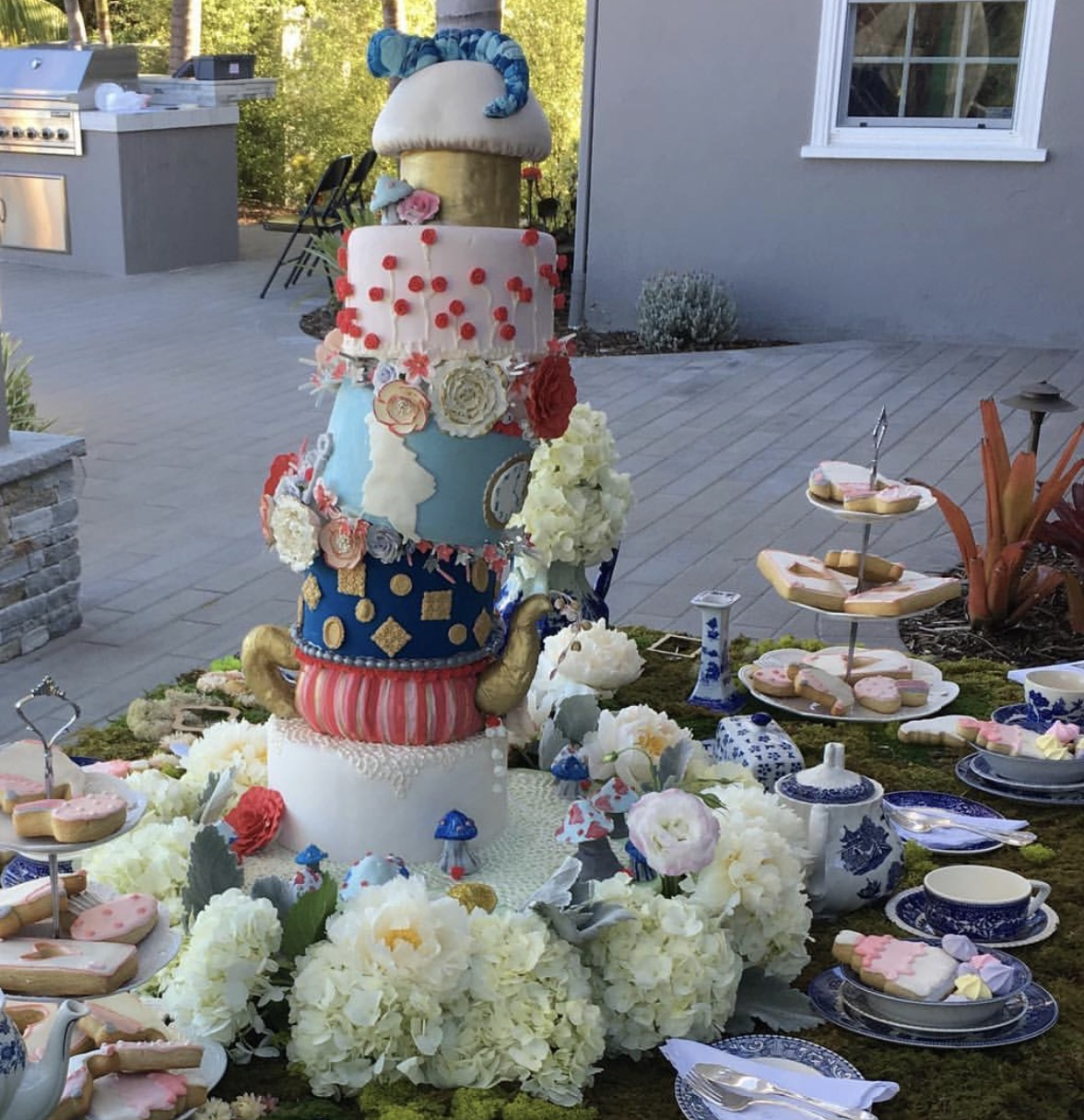Topsy Turvy Alice in Wonderland themed cake