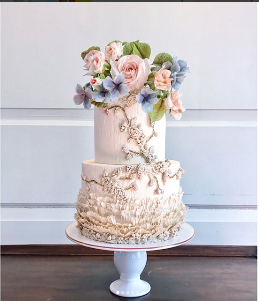 Ivory fondant Frill ruffle wedding cake with pastel sugar flowers