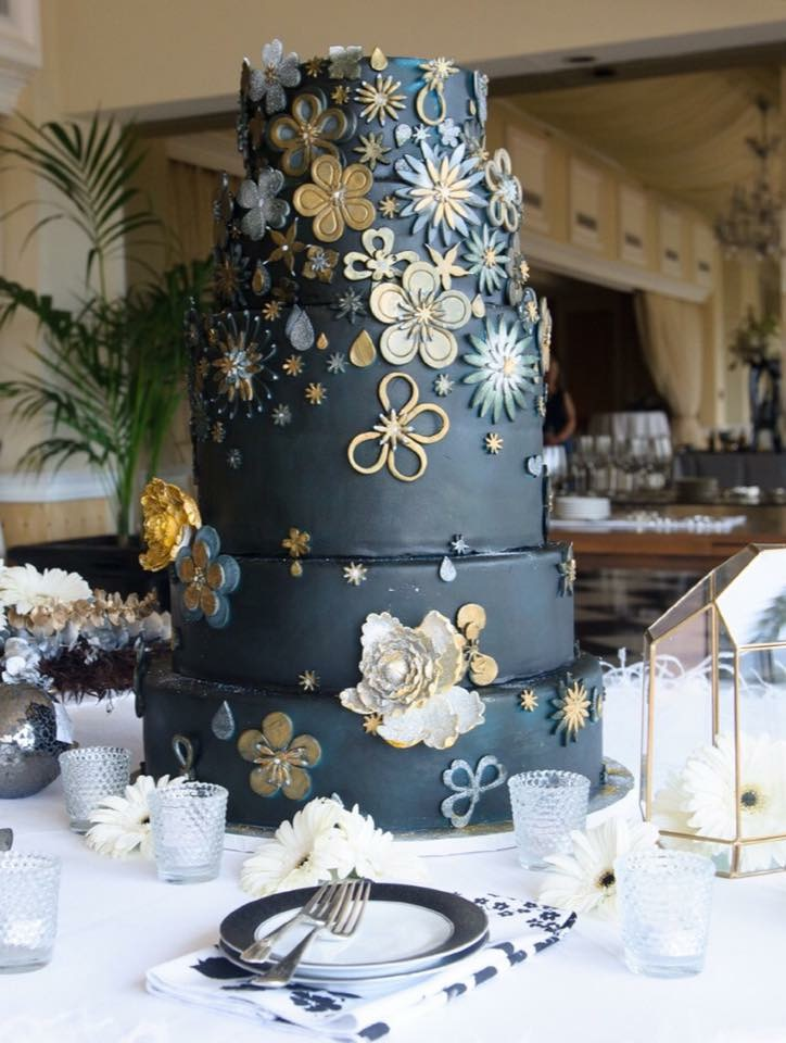 Black fondant wedding cake with gold and gray detailing