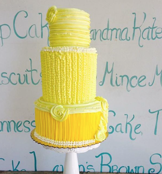 All yellow ruffled fondant wedding cake