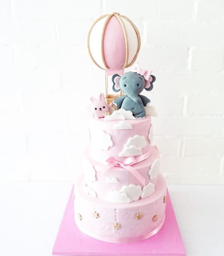 Baby pink and white fondant elephant cake