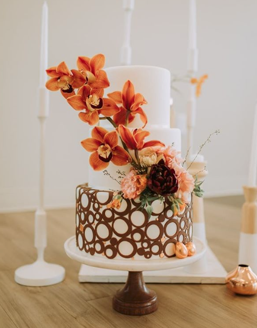 white fondant wedding cake with copper geometrics
