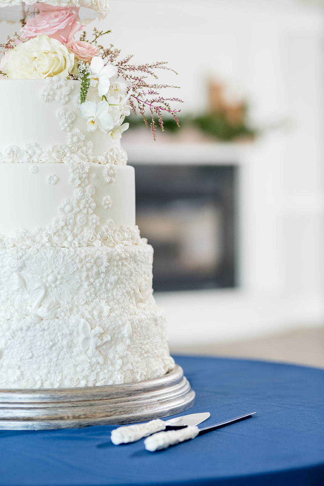 Bas relief textured white fondant wedding cake