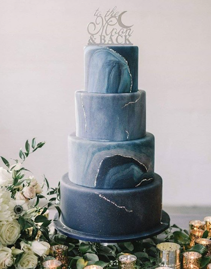 Navy blue celestial inspired fondant wedding cake