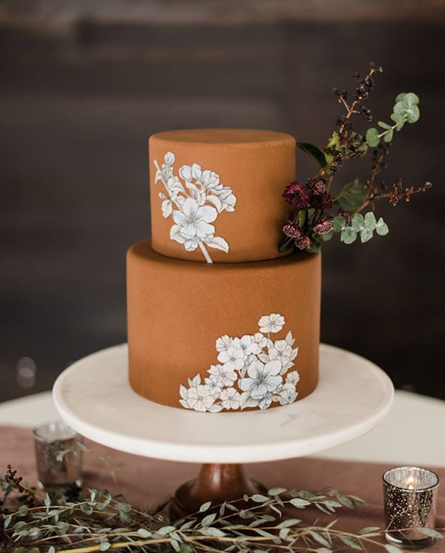 Caramel brown fondant wedding cake with hand painted white florals