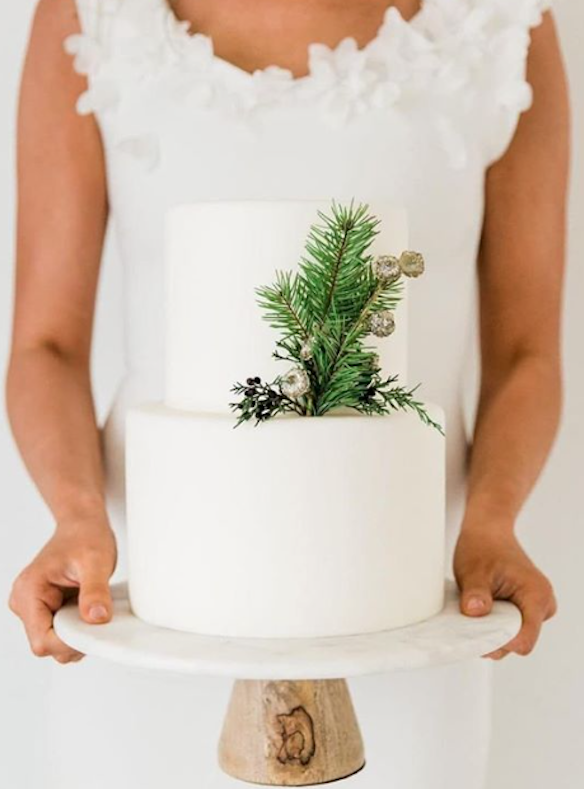 Winter white fondant wedding cake with evergreen