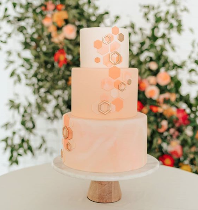 Peach fondant wedding cake with geometric design