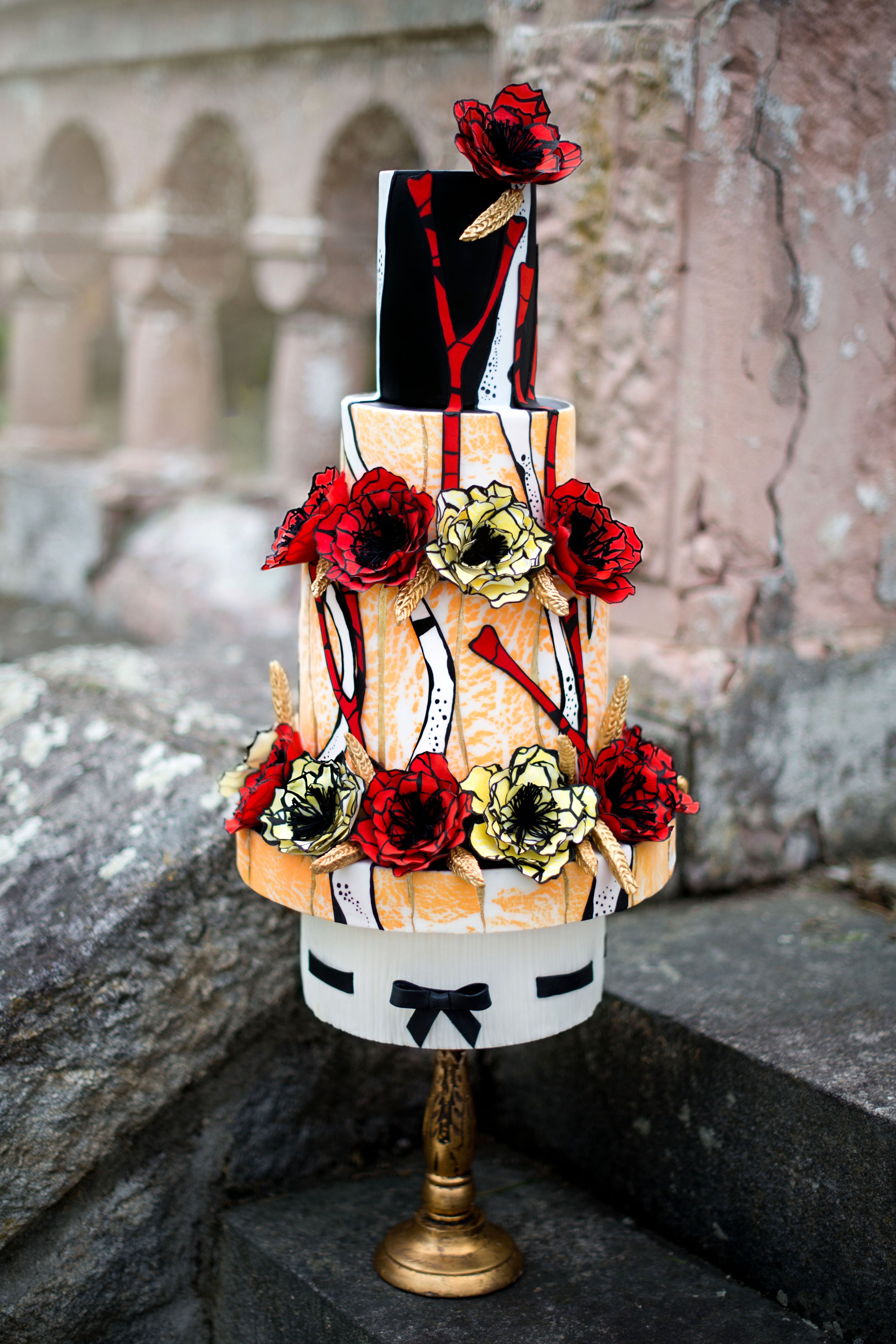 Black and red floral wedding cake with hand painted sugar flowers