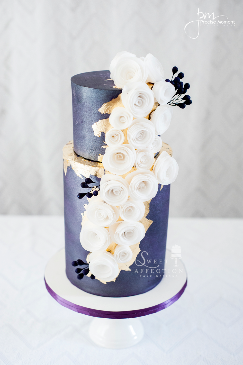 Purple wedding cake with white gum paste roses