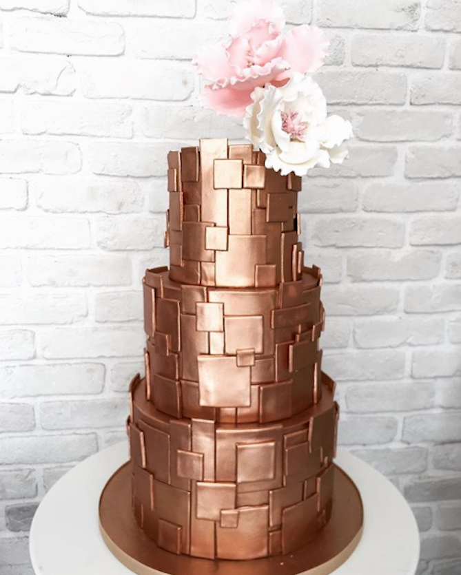 Embossed copper wedding cake made with Satin Ice