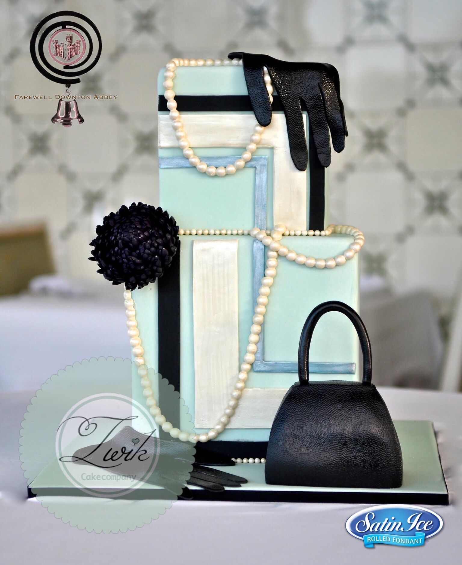 Light blue and black fondant cake